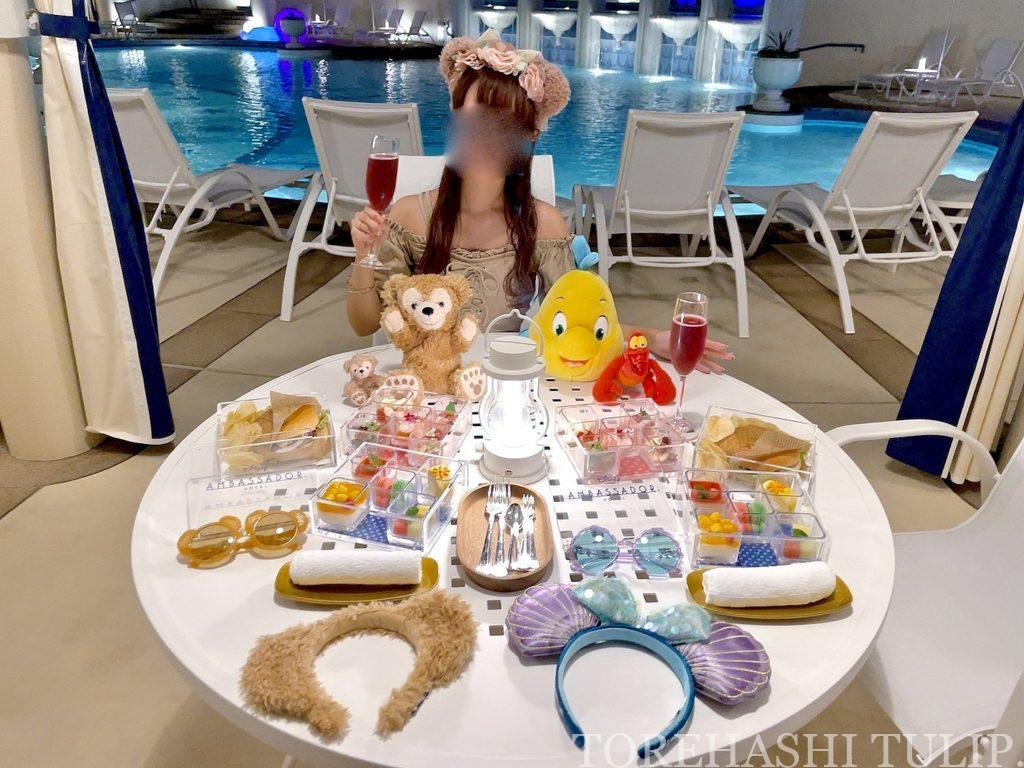 ディズニーホテル アンバサダーホテル パームガーデンプール ナイトプール 軽食メニュー インスタ映え レポ 2021年夏 チケット売り切れ キャスト 写真撮影 インスタ映えスポット ライト演出 感染症対策 マスク